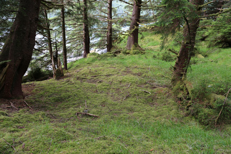 Image of an impression in the ground where a house would have stood at Cha'atl.