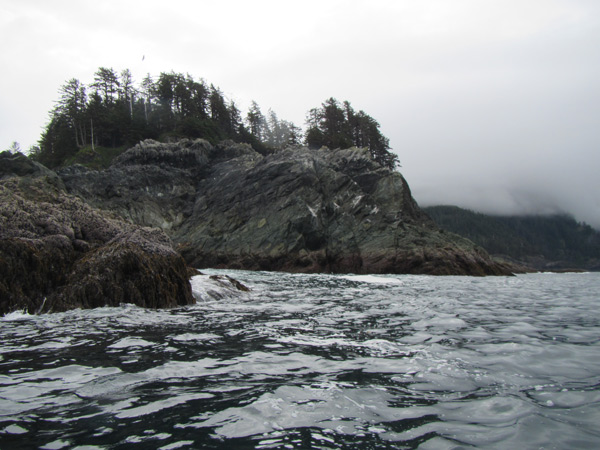 Paddling around the northwest point of Hibben Island next to the rocks in the confused seas.